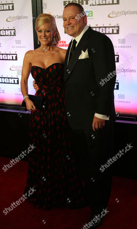 Stock Picture of Godaddy Ceo and Founder Bob Parsons (r) and His Wife Renee Parsons (l) Pose on the Red Carpet at the Muhammad Ali Celebrity Fight Night Xvii in Phoenix Arizona Usa on 19 March 2011 United States Phoenix