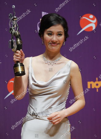 Stock Photo of Hong Kong Actress Michelle Ye Poses For Photographs with the Best Actress Award For Her Performance in the Movie 'Yi Ngoi' (accident) at the 29th Annual Hong Kong Film Awards in Hong Kong China 18 April 2010 the Hong Kong Film Award Ceremony Honours Achievement in Filmmaking This Ceremony is Considered As the Hong Kong Equivalent to the Us Academy Awards China Hong Kong