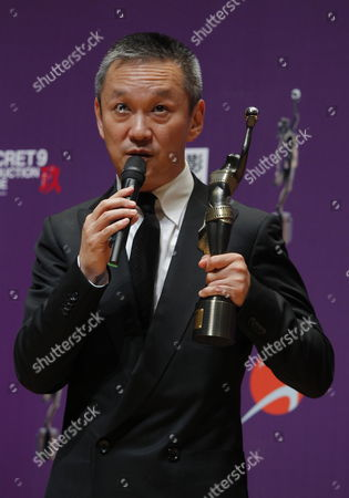 Hong Kong Director Teddy Chen Poses For Photographs with the Best Director Award For the Movie 'Bodyguards and Assassins' at the 29th Annual Hong Kong Film Awards in Hong Kong China 18 April 2010 the Hong Kong Film Award Ceremony Honours Achievement in Filmmaking This Ceremony is Considered As the Hong Kong Equivalent to the Us Academy Awards China Hong Kong