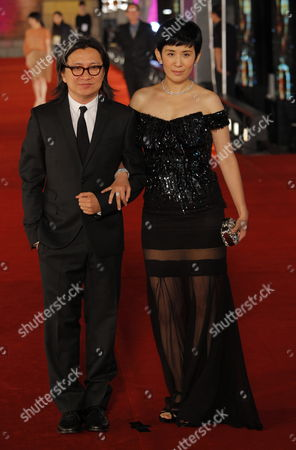 Hong Kong Director Peter Chan (l) and His Wife Hong Kong Actress Sandra Ng Nominee For Best Actress Arrive at the 29th Annual Hong Kong Film Awards in Hong Kong China 18 April 2010 the Hong Kong Film Award Ceremony Honours Achievement in Filmmaking This Ceremony is Considered As the Hong Kong Equivalent to the Us Academy Awards China Hong Kong