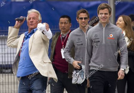 John Button (l) Father of British Formula One Driver Jenson Button (r) of Mclaren Mercedes Mimics Throwing an Umbrella As He Arrives at the Paddock at the Shanghai International Circuit in Shanghai China 15 April 2010 the 2010 Chinese Grand Prix Will Take Place on 18 April 2010 China Shanghai