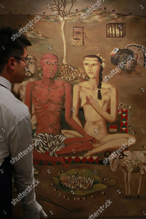 A Staff of Auction House Sotheby's Arrange a Part of a Painting by Chinese Painter Zhang Xiaogang Entitled 'Forever Lasting Love Series (triptych)' During a Press Preview in Hong Kong China 17 February 2011 the Painting is Estimated to Fetch 25 to 30 Million Hong Kong Dollars Or 3 2 to 3 8 Million Us Dollars and Will Be Auctioned As Part of Sotheby's Hong Kong Evening Sale of the Ullens Collection Which Will Be Held on 03 April This Year China Hong Kong