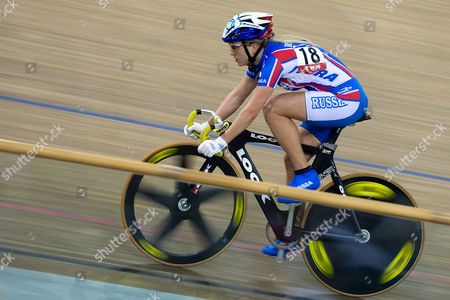 Russia's Eugeniya Romanyuta is on Her Way to Win the Women's Points Race at the 2009-2010 Track Cycling World Cup at the Laoshan Velodrome in Beijing China 23 January 2010 Romanyuta Won the Race Followed by Second Placed Megan Dunn of Australia and Third Placed Giorgia Bronzini of Italy China Beijing