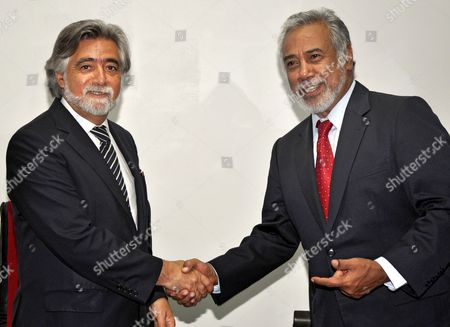 Stock Picture of Portuguese Minister For Foreign Affairs Luis Amado (l) is Greeted by East Timor's Prime Minister Xanana Gusmao During a Meeting in Dili East Timor 20 May 2011 Luis Amado is on a Three Days Visit to the Country to Attend the Celebration of the Restoration of Independence Day on 20 May East Timorese Were Celebrating Their Independence Day on 20 May with a Military Parade in the Capital Dili to Commemorate the Country's Indepedence in 2002 East Timor Dili