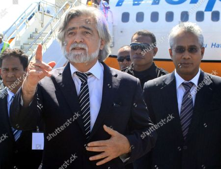 Portuguese Minister For Foreign Affairs Luis Amado (l) Gestures As He is Accompanied by His East Timorese Counterpart Zacarias Da Costa (r) During His Arrival at Komoro Airport in Dili East Timor 19 May 2011 Luis Amado is on a Three Days Visit to the Country East Timor Dili