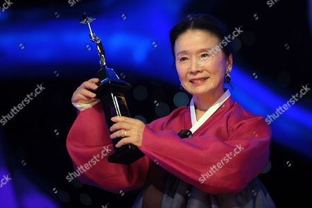 Stock Picture of South Korean Actress Yun Jung Hee Receives a Tribute Award During the Opening Ceremony of the 34th Cairo International Film Festival (ciff) at the Opera House in Cairo Egypt 30 November 2010 the 34th Cairo Film Festival Takes Place From 30 November to 09 December 2010 and Focuses on Both Arab and International Cinema Egypt Cairo