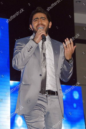 A Picture Made Available on 03 January 2009 Shows Egyptian Singer Tamer Hosny During a Celebration Held For the New Year's Eve at Semiramis Hotel in Cairo Egypt on 31 December 2009 Egypt Cairo
