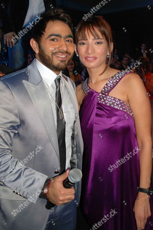 A Picture Made Available on 03 January 2009 Shows Egyptian Singer Tamer Hosny (l) and Egyptian Singer Zeina (r) Posing For Photographers During a Celebration Held For the New Year's Eve at Semiramis Hotel in Cairo Egypt on 31 December 2009 Egypt Cairo