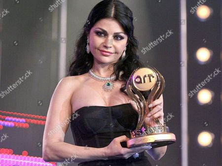 A Picture Made Available on 11 May 2010 Shows Lebanese Model and Pop Star Haifa Wehbe Holding Her Best Singer-actress Prize During the Art Music Film and Television Awards Ceremony at the Grand Hayat Hotel in Cairo Egypt Late 10 May 2010 Wehbe Won the Award For Her Role in the 2009 Film 'Dokan Shehata ' Directed by Egyptian Filmmaker Khaled Yussef Art the Arab Radio and Television Network is a Producer of Premium Arabic Family Programming and Entertainment Worldwide Egypt Cairo