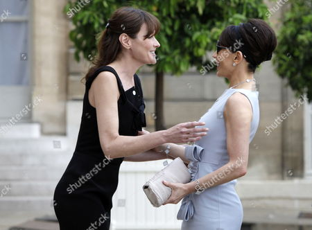 French First Lady Carla Bruni Sarkozy (l) Greets Gabonese First Lady Sylvia Bongo Ondimba (r) at the Elysee Palace in Paris France 13 July 2010 Before a Tea Reception with Several African Leaders Spouses Fourteen African Countries Will Be Honour Guest and Will Parade Beside the French Army on the Champs Elysees During the French Traditional Parade on 14 July 2010 France Paris