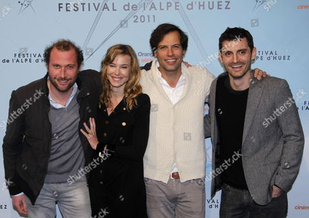 (l-r) Belgian Actor Francois Damiens French Actress Pascale Arbillot French Actor Laurent Lafitte and French Director Alexandre Coffre Pose For Photographs As They Attend the 14th Annual International Comedy Film Festival in L'alpe D'huez France 20 January 2011 the Movie 'Une Pure Affaire' by Alexandre Coffre is Presented in the Official Competition at the Festival Running From 18 to 23 January France Alpe D'huez