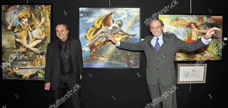 Pal Sarkozy (2-r) and Werner Hornung (2-l) Pose For Photographers in Front of 'Take Your Seat' (l) 'Skydiving' (c) and 'Going Nowhere Fast' (r) Paintings During the Vernisage of the 'Entente Subtile' Exhibit by Pal Sarkozy and Werner Hornung at the Espace Pierre Cardin in Paris France 24 April 2010 the Exhibit Runs Until 09 May Pal Father of French President Nicolas Sarkozy Began Collaboration with Werner Hornung in 2004 France Paris
