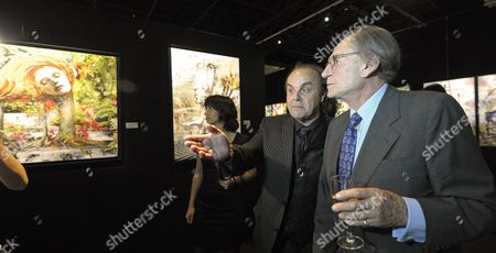 Pal Sarkozy (r) and Werner Hornung Walk by 'Hairy Fairy' Painting at the Vernisage of the 'Entente Subtile' Exhibit by Pal Sarkozy and Werner Hornung at the Espace Pierre Cardin in Paris France 24 April 2010 the Exhibit Runs Until 09 May Pal Father of French President Nicolas Sarkozy Began Collaboration with Werner Hornung in 2004 France Paris
