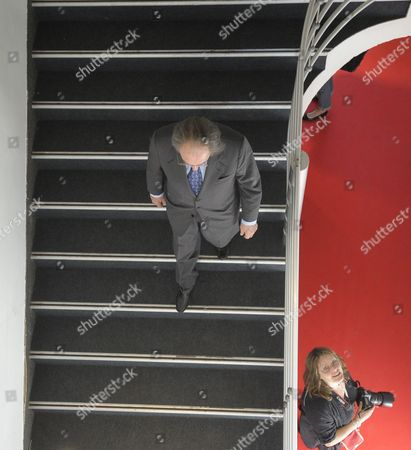 A Photographer Waits As Pal Sarkozy (c) Walks Downstairs to Greet Guests During the Vernisage of the 'Entente Subtile' Exhibit by Pal Sarkozy and Werner Hornung at the Espace Pierre Cardin in Paris France 24 April 2010 the Exhibit Runs Until 09 May Pal Father of French President Nicolas Sarkozy Began Collaboration with Werner Hornung in 2004 France Paris