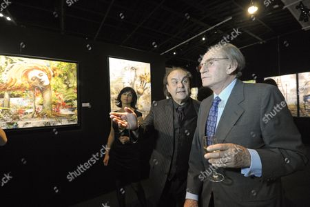 Pal Sarkozy (r) and Werner Hornung (c) Walk by 'Hairy Fairy' Painting at the Vernisage of the 'Entente Subtile' Exhibit by Pal Sarkozy and Werner Hornung at the Espace Pierre Cardin in Paris France 24 April 2010 the Exhibit Runs Until 09 May Pal Father of French President Nicolas Sarkozy Began Collaboration with Werner Hornung in 2004 France Paris