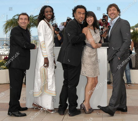 Stock Photo of (l-r) Spanish Actor Eduard Fernandez Actress Diaryatou Daff Mexican Director Alejandro Gonzalez Inarritu Argentinian Actress Maricel Alvarez and Spanish Actor Javier Bardem Pose During the Photocall of the Movie 'Biutiful' During the 63rd Cannes Film Festival in Cannes France 17 May 2010 the Movie by Alejandro Gonzalez Inarritu is Presented in Competition at the Cannes Film Festival 2010 Running From 12 to 23 May France Cannes