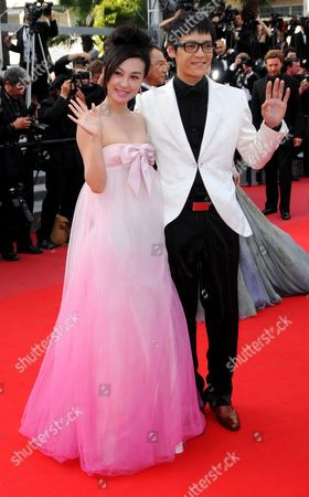 Stock Photo of Chinese Actor Zi Yi (r) and Chinese Actress Li Feier (l) Arrive For the Closing Award Ceremony of the 63rd Cannes Film Festival in Cannes France 23 May 2010 the Award Ceremony Will Determine This Year's Palme D'or Award and Will Be Followed by the Screening of 'The Tree' by French Director Julie Bertuccelli Presented out of Competition of the Cannes Film Festival 2010 France Cannes