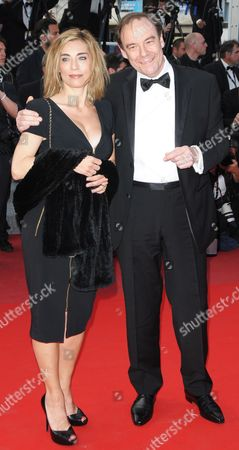 Stock Picture of French Producer Xavier Couture (r) Arrives with His Wife For the Screening of the Movie 'Wall Street - Money Never Sleeps' During the 63rd Cannes Film Festival in Cannes France 14 May 2010 the Movie by Us Director Oliver Stone is Presented out of Competition at the Cannes Film Festival 2010 Running From 12 to 23 May France Cannes