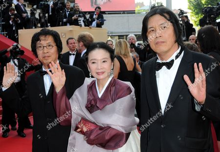 (l-r) Producer Lee Joondong Korean Actress Yun Junghee and South Korean Director Lee Chang-dong Arrive For the Closing Award Ceremony of the 63rd Cannes Film Festival in Cannes France 23 May 2010 the Award Ceremony Will Determine This Year's Palme D'or Award and Will Be Followed by the Screening of 'The Tree' by French Director Julie Bertuccelli Presented out of Competition of the Cannes Film Festival 2010 France Cannes