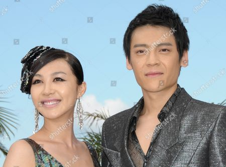Stock Picture of Chinese Actress Li Feier (l) and Chinese Actor Zi Yi (r) Pose During the Photocall of the Movie 'Rizhao Chongqing' (chongqing Blues) During the 63rd Cannes Film Festival in Cannes France 13 May 2010 the Movie by Chinese Director Wang Xiaoshuai is Presented in Competition at the Cannes Film Festival 2010 Running From 12 to 23 May France Cannes