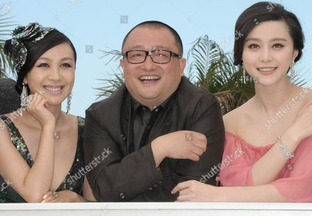 Chinese Director Wang Xiaoshuai (c) Poses with Chinese Actresses and Cast Members Li Feier (l) and Fan Bingbing (r) During the Photocall of the Movie 'Rizhao Chongqing' (chongqing Blues) During the 63rd Cannes Film Festival in Cannes France 13 May 2010 the Movie by Chinese Director Wang Xiaoshuai is Presented in Competition at the Cannes Film Festival 2010 Running From 12 to 23 May France Cannes