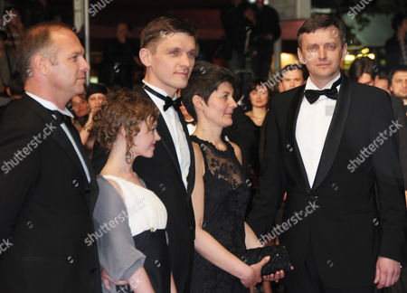 Stock Photo of Ukrainian Director Sergei Loznitsa (r) Arrives with Actors Viktor Nemets (3-l) Olga Shuvalova (2-l) and Guests For the Screening of the Movie 'Schastye Moe' (my Joy) During the 63rd Cannes Film Festival in Cannes France 19 May 2010 the Movie by Sergei Loznitsa is Presented in Competition at the Cannes Film Festival 2010 Running From 12 to 23 May France Cannes