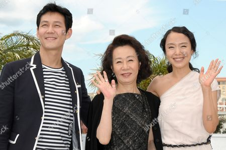 (l-r) South-korean Actors Lee Jung-jae Youn Yuh-jung and Jeon Do-youn Pose During the Photocall of the Movie 'The Housemaid' During the 63rd Cannes Film Festival in Cannes France 14 May 2010 the Movie by Im Sang-soo is Presented in Competition at the Cannes Film Festival 2010 Running From 12 to 23 May France Cannes