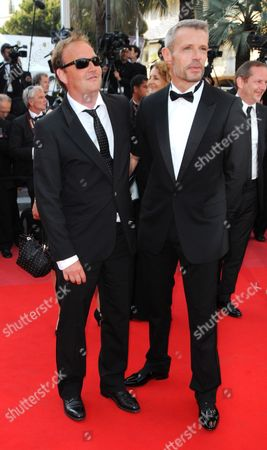 French Director Xavier Beauvois (l) and French Actor Lambert Wilson (r) Arrive For the Closing Award Ceremony of the 63rd Cannes Film Festival in Cannes France 23 May 2010 the Award Ceremony Will Determine This Year's Palme D'or Award and Will Be Followed by the Screening of 'The Tree' by French Director Julie Bertuccelli Presented out of Competition of the Cannes Film Festival 2010 France Cannes