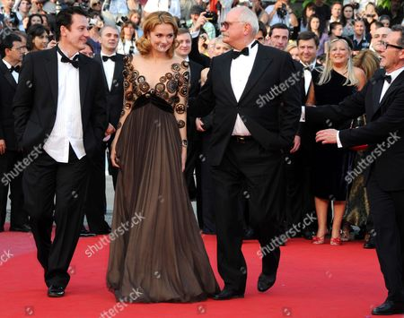 Stock Picture of (l-r) Russian Actor Oleg Menshikov Russian Actress Nadezhda Mihalkova and Russian Director Nikita Mikhalkov Arrive For the Screening of the Movie 'Utomlyonnye Solntsem 2: Predstoyanie' (the Exodus - Burnt by the Sun 2) During the 63rd Cannes Film Festival in Cannes France 22 May 2010 the Movie by Nikita Mikhalkov is Presented in Competition at the Cannes Film Festival 2010 Running From 12 to 23 May France Cannes