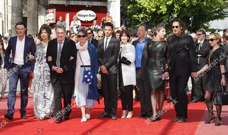 (l-r) British Actor Luke Evans Lola Frears British Director Stephen Frears His Wife British Artist Anne Rothenstein British Actor Dominic Cooper British Writer Posy Simmonds Actor Bill Camp British Actress Tamsin Greig French Composer and Jury Member Alexandre Desplat and Guest Arrive For the Screening of the Movie 'Tamara Drewe' During the 63rd Cannes Film Festival in Cannes France 18 May 2010 the Movie by Stephen Frears is Presented in Competition at the Cannes Film Festival 2010 Running From 12 to 23 May France Cannes