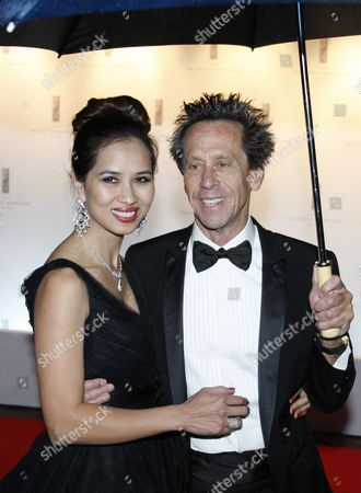 Us Producer Brian Grazer (r) Arrives with Chau-giang Thi Nguyen (l) at the Opening Ceremony Dinner Held at the Majestic Hotel After the Opening Ceremony of the 63rd Cannes Film Festival in Cannes France 12 May 2010 the Cannes Film Festival 2010 Runs From 12 to 23 May France Cannes