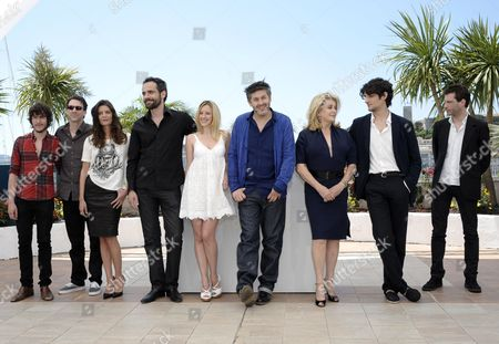(l-r) Actor Dustin Segura Suarez Actor Paul Schneider French Actress Chiara Mastroianni Actor Rasha Bukvic French Actress Ludivine Sagnier French Director Christophe Honore French Actress Catherine Deneuve French Actor Louis Garrel and French Composer Alex Beaupain Pose During the Photocall For 'Les Bien-aimes' (beloved) at the 64th Cannes Film Festival in Cannes France 21 May 2011 the Screening of the Movie by Christophe Honore Presented out of Competition Will Close the Film Festival Running From 11 to 22 May France Cannes
