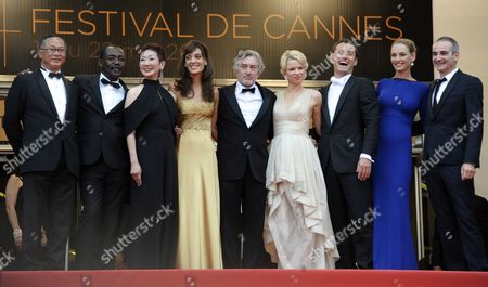 (l-r) Jury Members Hong Kong Director Johnnie to Chadian Director Mahamat Saleh Haroun Hong Kong Producer Nansun Shi Argentine Actress Martina Gusman Us Director Robert De Niro Norwegian Writer Linn Ullmann British Actor Jude Law Us Actress Uma Thurman and French Director Olivier Assayas Arrive For the Screening of 'Les Bien-aimes' (beloved) and the Closing Award Ceremony of the 64th Cannes Film Festival in Cannes France 22 May 2011 the Screening of the Movie by French Director Christophe Honore Presented out of Competition Closes the Film Festival France Cannes