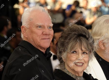 British Actor Malcolm Mcdowell (l) and Stanley Kubrick's Widow Christiane Kubrick (r) Arrive For the Screening of 'La Piel Que Habito' (the Skin i Live In) During the 64th Cannes Film Festival in Cannes France 19 May 2011 the Movie by Spanish Director Pedro Almodovar is Presented in the Official Competition of the Film Festival Running From 11 to 22 May France Cannes