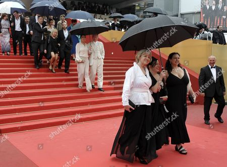Austrian Actresses Christine Kain (front L) Gisella Salcher (front C) and Guests Shelter Under Umbrellas As They Leave the Screening of 'Michael' During the 64th Cannes Film Festival in Cannes France 14 May 2011 the Movie by Austrian Director Markus Schleinzer was Presented in the Official Competition of the Film Festival Running From 11 to 22 May France Cannes