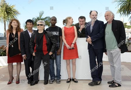 (l-r) Evelyne Didi Actor Quoc Dung-nguyen French Rock Singer Little Bob Blondin Miguel Finnish Actress Kati Outinen Finnish Director Aki Kaurismaki French Actors Jean-pierre Darroussin and Andre Wilms Pose During the Photocall For 'Le Havre' at the 64th Cannes Film Festival in Cannes France 17 May 2011 the Movie by Aki Kaurismaki is Presented in the Official Competition of the Film Festival Running From 11 to 22 May France Cannes
