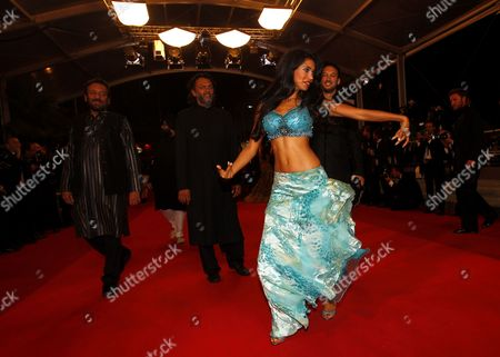 A Bollywood Dancer Performs on the Red Carpet As Indian Producer Shekhar Kapur (l) Indian Director Rakeysh Omprakash Mehra (c) and Us Director Jeffrey Zimbalist (r) Arrive For the Screening of 'Bollywood the Greatest Love Story Ever Told' During the 64th Cannes Film Festival in Cannes France 14 May 2011 the Movie by Rakeysh Omprakash Mehra and Jeffrey Zimbalist is Presented out of Competition at the Film Festival Running From 11 to 22 May France Cannes