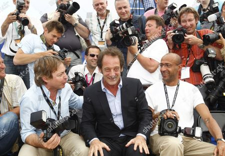 French Actor Vincent Lindon (c) Poses Among Photographers During the Photocall For 'Pater' at the 64th Cannes Film Festival in Cannes France 18 May 2011 the Movie by French Director Alain Cavalier is Presented in the Official Competition of the Film Festival Running From 11 to 22 May France Cannes