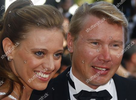 Finnish Former Formula 1 Driver Mika Hakkinen (r) and His Partner Marketa Kromatova Arrive For the Screening of 'The Tree of Life' During the 64th Cannes Film Festival in Cannes France 16 May 2011 the Movie by Us Director Terrence Malick is Presented in the Official Competition of the Film Festival Running From 11 to 22 May France Cannes