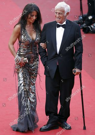 Stock Picture of French Actor Jean-paul Belmondo (r) and His Girlfriend Barbara Gandolfi (l) Arrive to a Tribute Ceremony During the 64th Cannes Film Festival in Cannes France 17 May 2011 the Film Festival Running From 11 to 22 May is Paying Tribute to Jean-paul Belmondo For His Career France Cannes