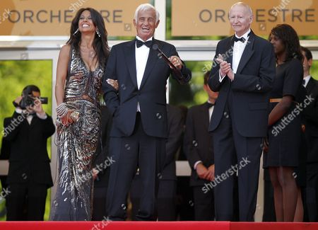 Stock Image of President of the Festival Gilles Jacob (r) Welcome French Actor Jean-paul Belmondo (c) and His Girlfriend Barbara Gandolfi (l) As They Arrive to a Tribute Ceremony During the 64th Cannes Film Festival in Cannes France 17 May 2011 the Film Festival Running From 11 to 22 May is Paying Tribute to Jean-paul Belmondo For His Career France Cannes