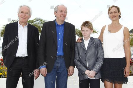 (l-r) Belgian Director Jean-pierre Dardenne Belgian Director Luc Dardenne Belgian Actor Thomas Doret and Belgian Actress Cecile De France Pose During the Photocall For 'Le Gamin Au Velo' (the Kid with the Bike) at the 64th Cannes Film Festival in Cannes France 15 May 2011 the Movie by Jean-pierre and Luc Dardenne is Presented in the Official Competition of the Film Festival Running From 11 to 22 May France Cannes