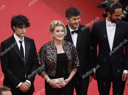 (l-r) French Actor Louis Garrel French Actress Catherine Deneuve French Director Christophe Honore and Actor Rasha Bukvic Arrive For the Screening of 'Les Bien-aimes' (beloved) and the Closing Award Ceremony of the 64th Cannes Film Festival in Cannes France 22 May 2011 the Screening of the Movie by Christophe Honore Presented out of Competition Closes the Film Festival France Cannes