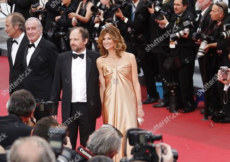 French Actors Denis Podalydes (c) and Florence Pernel (r) Arrive For the Screening of 'La Conquete' (the Conquest) During the 64th Cannes Film Festival in Cannes France 18 May 2011 the Movie by French Director Xavier Durringer is Presented out of Competition at the Film Festival Running From 11 to 22 May France Cannes