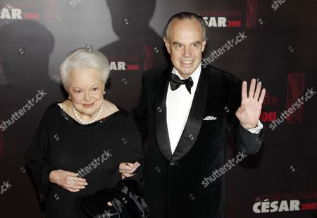 British Us Actress Olivia De Havilland (l) and French Minister of Culture and Communication Frederic Mitterrand (r) Arrive For the 36th Cesar Awards Ceremony Held at the Chatelet Theatre in Paris France 25 February 2011 the 'Academie Des Arts Et Techniques Du Cinema' of France Honours Excellence in 21 Categories France Paris