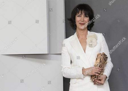Stock Photo of French Actress Anne Alvaro Holds the Best Supporting Actress Award For Her Role in 'Le Bruit Des Glacons' As She Poses For Photographs in the Press Room During the 36th Cesar Awards Ceremony Held at the Chatelet Theatre in Paris France 25 February 2011 the 'Academie Des Arts Et Techniques Du Cinema' of France Honours Excellence in 21 Categories France Paris