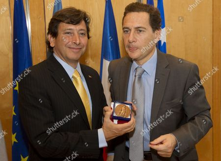 French Energy Industry and Digital Economy Minister Eric Besson (r) Poses with Chilean Minister of Mining Laurence Golborne (l) After They Exchanged Gifts During a Trade Agreement Meeting at the Finance Ministry in Paris France 24 February 2011 France Paris