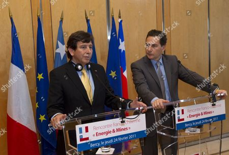 French Energy Industry and Digital Economy Minister Eric Besson (r) Speaks with Chilean Minister of Mining Laurence Golborne (l) As They Meet For Trade Agreements at the Finance Ministry in Paris France 24 February 2011 France Paris