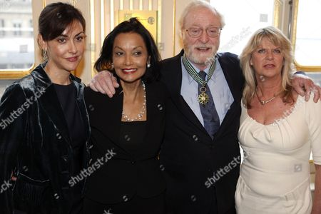 Stock Picture of British Actor Sir Michael Caine (2-r) Poses with His Wife Shakira Baksh (2-l) and His Daughters Dominique (r) and Natasha (l) After Being Granted the Knight of the Order of Arts and Letters Award During a Ceremony at the Ministry of Culture in Paris France 06 January 2011 France Paris