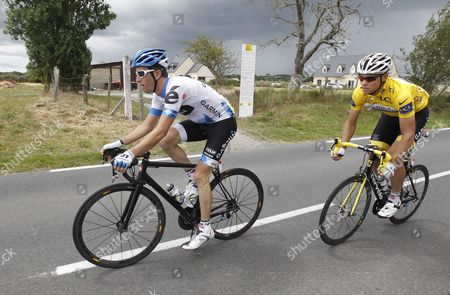 Garmin-cervelo Team Rider Christian Vandevelde of the Us (l) Cycles Ahead of Garmin-cervelo Team Rider Thor Hushovd of Norway Wearing the Overall Leader's Yellow Jersey During the 6th Stage of the Tour De France Cycling Race Between Dinan and Lisieux France 07 July 2011 France Dinan